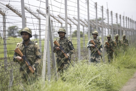 Border Security Force (BSF) soldiers patrol along the India-Pakistan border in Akhnoor near Jammu, on August 14, 2019. (Representative image/Rakesh BAKSHI / AFP)
