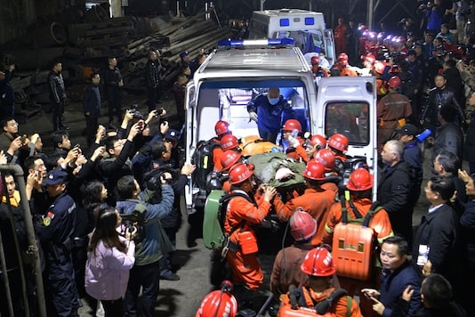 Rescue workers transfer a survivor to an ambulance at the Shanmushu coal mine owned by Sichuan Coal Industry Group, following a flooding accident at the mine on Saturday, in Yibin, Sichuan province, China December 18, 2019. China Daily via REUTERS