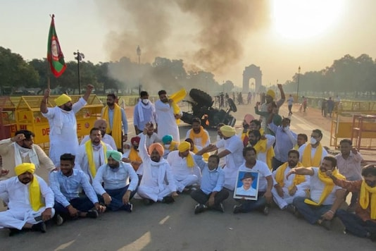 Congress workers protest the farm legislations at India Gate.