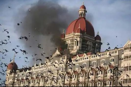 File photo. Smoke billows out from burning Taj Mahal hotel during 26/11 attacks in Mumbai. (File photo/ Reuters)
