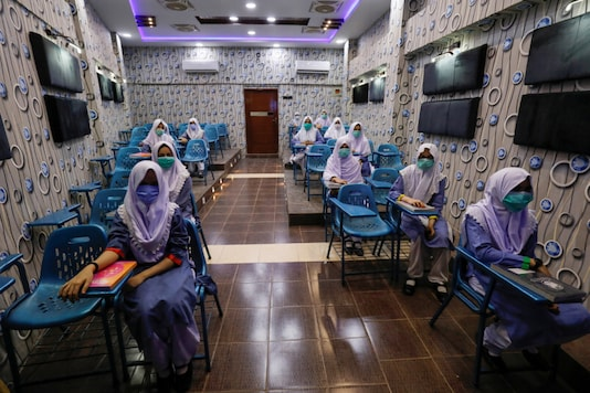 Students keep safe distance while attending an audio-visual class, as schools reopen amid the coronavirus disease (COVID-19) pandemic, in Karachi, Pakistan September 15, 2020. REUTERS/Akhtar Soomro