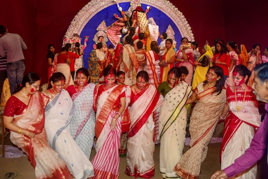 Bengali women dance during 'Sindur Khela' on the occasion of 'Vijay Dashami' at a Durga Puja pandal in Allahabad. (PTI/File photo)