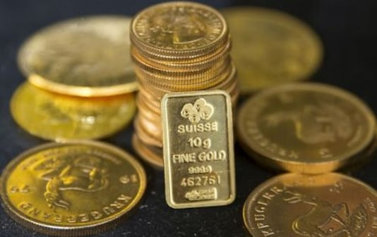 Gold Dips On Stronger Dollar Ahead Of ECB Meeting