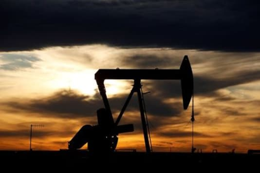 GLOBAL-OIL:Oil edges lower, shrugging off Gulf of Mexico shut-ins