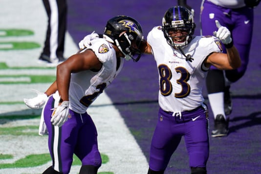 Baltimore Ravens wide receiver Willie Snead (83) celebrates a touchdown by Baltimore Ravens running back J.K. Dobbins (27), during the second half of an NFL football game, Sunday, Sept. 13, 2020, in Baltimore, MD. (AP Photo/Julio Cortez)