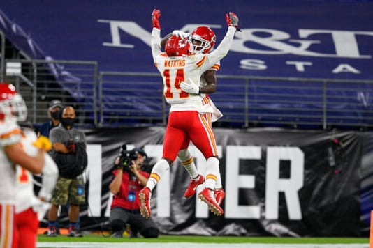 Kansas City Chiefs wide receivers Sammy Watkins (14) and Mecole Hardman (17) celebrate Hardman's touchdown during the first half of an NFL football game against the Baltimore Ravens, Monday, Sept. 28, 2020, in Baltimore. (AP Photo/Nick Wass)