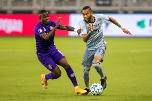 Sporting Kansas City defender Amadou Dia (13) attempts to maneuver past the defense of Orlando City midfielder Sebas Mendez (8) during an MLS soccer game, Wednesday, Sept. 23, 2020 at Children's Mercy Park in Kansas City, Kan. (Nick Tre. Smith/The Kansas City Star via AP)