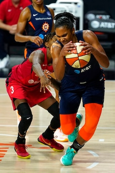 Connecticut Sun forward Alyssa Thomas (25) grabs a loose ball away from Las Vegas Aces guard Danielle Robinson (3) during the second half of Game 3 of a WNBA basketball semifinal round playoff series Thursday, Sept. 24, 2020, in Bradenton, Fla. (AP Photo/Chris O'Meara)