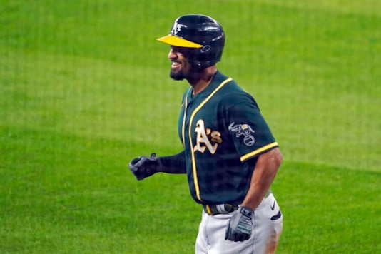 Oakland Athletics' Marcus Semien smiles as he heads to the dugout after hitting a three-run home run during the fourth inning of the first baseball game against the Seattle Mariners in a doubleheader, Monday, Sept. 14, 2020, in Seattle. (AP Photo/Ted S. Warren)