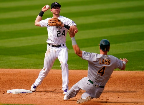 Oakland Athletics' Jake Lamb (4) is forced out at second by Colorado Rockies second baseman Ryan McMahon (24) during the sixth inning of a baseball game, Wednesday, Sept. 16, 2020, in Denver. (AP Photo/Jack Dempsey)