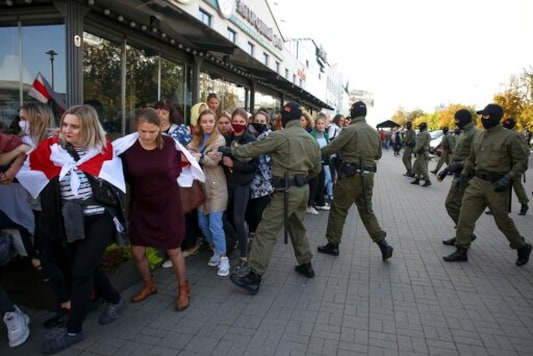Police officers detain women during an opposition rally to protest the official presidential election results in Minsk, Belarus, Saturday, Sept. 19, 2020. Daily protests calling for the authoritarian president's resignation are now in their second month and opposition determination appears strong despite the detention of protest leaders. (AP Photo/TUT.by)
