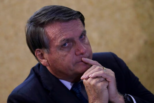 Brazil's President Jair Bolsonaro attends the launch of the Mining and Development Program, at the headquarters of the Ministry of Mines and Energy, in Brasilia, Brazil, Monday, Sept. 28, 2020. (AP Photo/Eraldo Peres)