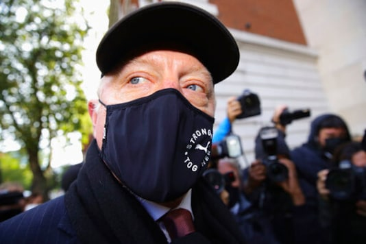 Retired German tennis player Boris Becker, foreground, arrives at Westminster Magistrates Court in London, after being declared bankrupt and accused of not complying with obligations to disclose information, Thursday, Sept. 24, 2020. Becker is being prosecuted by the Insolvency Service. (Aaron Chown/PA via AP)
