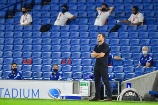 Chelsea's head coach Frank Lampard watches play during the English Premier League soccer match between Brighton and Chelsea at Falmer Stadium in Brighton, England, Monday, Sept. 14, 2020. (Glynn Kirk/Pool via AP)