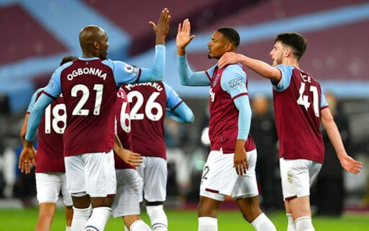West Ham's Sebastien Haller, second right, is congratulated by teammates after scoring his team's fourth goal during the English Premier League soccer match between West Ham and Wolverhampton Wanderers at London Stadium, London, England, Sunday, Sept. 27, 2020. (Justin Setterfield/Pool via AP)