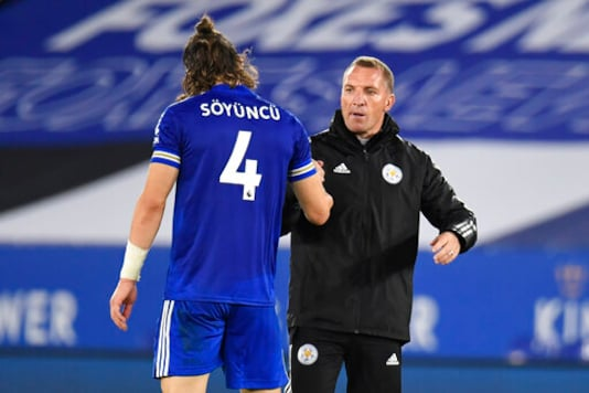 Leicester's head coach Brendan Rodgers , right, greets Leicester's Caglar Soyuncu after the English Premier League soccer match between Leicester City and Burnley at the King Power Stadium, Leicester, England, Sunday, Sept. 20, 2020. (Peter Powell, Pool via AP)