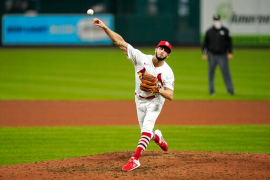 St. Louis Cardinals starting pitcher Daniel Ponce de Leon throws during the fifth inning in the second game of a baseball doubleheader against the Milwaukee Brewers Friday, Sept. 25, 2020, in St. Louis. (AP Photo/Jeff Roberson)