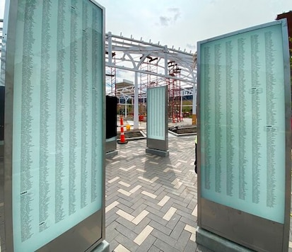 This photo provided by MKSK shows some of the 11 pylons that list every player who played a down in an NFL regular or postseason game, in Centennial Plaza under construction in downtown Canton, Ohio. Centennial Plaza, developed with the help of $12 million in funding from the citizens and businesses of Canton, will occupy a two-acre city block formerly known as Market Square. (Courtesy of MKSK/Pro Football Hall of Fame via AP)