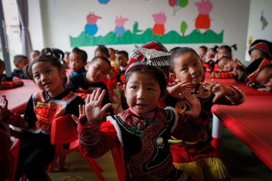 Ethnic minority children wearing their costumes learn to sing at a kindergarten class at the apartment houses compound built by the Chinese government in Yuexi county, southwest China's Sichuan province on Sept. 11, 2020. China's ruling Communist Party says its initiatives have helped to lift millions of people out of poverty. But they can require drastic changes, sometimes uprooting whole communities. They fuel complaints the party is trying to erase cultures as it prods minorities to embrace the language and lifestyle of the Han who make up more than 90% of Chinas population. (AP Photo/Andy Wong)