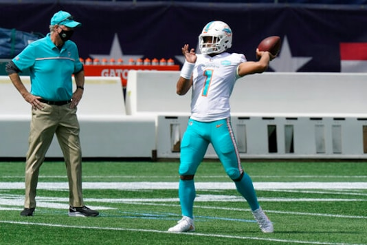 FILE - Miami Dolphins quarterback Tua Tagovailoa warms up before an NFL football game against the New England Patriots, Sunday, Sept. 13, 2020, in Foxborough, Mass. The Dolphins self-professed placeholder at quarterback played like one in the season opener, amplifying questions about the teams timetable for turning to rookie Tua Tagovailoa. Veteran Ryan Fitzpatrick threw three interceptions in Miamis loss at New England.(AP Photo/Steven Senne, File)