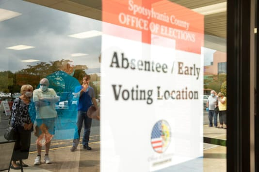 Voters wait in line to cast ballots in the general election, Friday, Sept. 18, 2020, at the Office of Elections satellite location in Spotsylvania, Va., on the first day of the state's 45-day early voting period. (Mike Morones/The Free Lance-Star via AP)