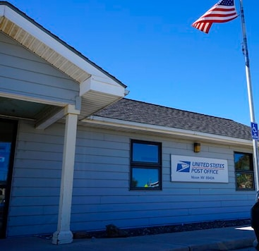 The U.S. Post Office in Nixon, Nev. is seen on Tuesday, Sept. 8, 2020. The majority of the more than 1,300 Pyramid Lake Paiute tribal members receive their mail in shared P.O. boxes at the reservations sole U.S. Post Office in Nixon, Nev., which is only open from 11:00 a.m. to 3:30 p.m. Post offices on tribal lands will play an integral role in ensuring Native Americans can access voting in Nevada and elsewhere in the U.S. West in the 2020 election, but advocates worry residents of sprawling, rural reservations who lack transportation may struggle to get to the post office. (AP Photo/Sam Metz)