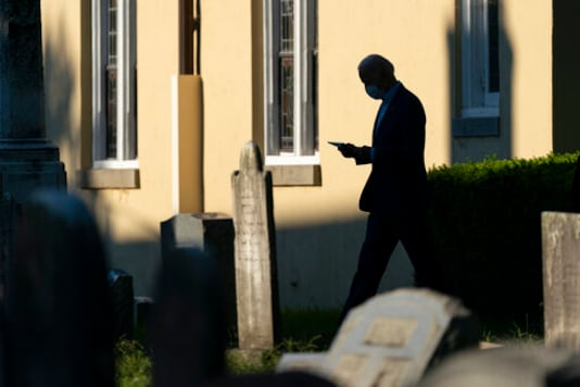 Democratic presidential candidate and former vice president Joe Biden walks from St. Joseph on the Brandywine, a Roman Catholic Church, after attending mass in Wilmington, Del., Sunday, Sept. 20, 2020. (AP Photo/Carolyn Kaster)