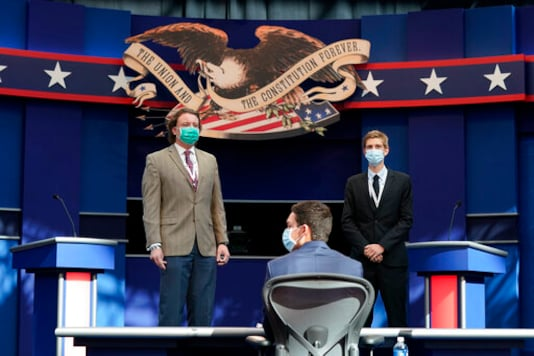 Mock debaters stand onstage as preparations take place for the first Presidential debate in the Sheila and Eric Samson Pavilion, Monday, Sept. 28, 2020, in Cleveland. The first debate between President Donald Trump and Democratic presidential candidate, former Vice President Joe Biden is scheduled to take place Tuesday, Sept. 29. (AP Photo/Patrick Semansky)
