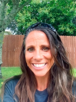 In this Sept. 22, 2020, photo provided by Kirsten Moore, the Port Richey, Fla., resident poses for a selfie. Moore says Republicans in the U.S. Senate should push ahead in confirming whoever President Donald Trump nominates for the U.S. Supreme Court. While filling the Supreme Court vacancy with a conservative jurist is important, she says its one of many reasons she is again voting for Trump. Moore is a pro-choice Republican, but she says abortion rights is not a litmus test for her vote in November. (Kirsten Moore via AP)