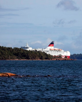 Viking Line's cruise ship M/S Amorella is seen near the Aland islands, seen from Finland, Sunday, Sept. 20, 2020. Finnish authorities say a Baltic Sea passenger ferry with nearly 300 people has run aground in the Aland Islands archipelago between Finland and Sweden without injuries. (Niclas Norlund/Lehtikuva via AP)