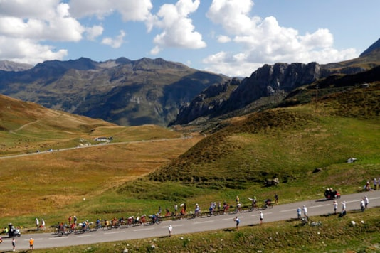 Riders in the breakeway climb Cormet de Roselend during the stage 18 of the Tour de France cycling race over 175 kilometers (108.7 miles) from Meribel to La Roche-sur-Foron, France, Thursday, Sept. 17, 2020. (AP Photo/Thibault Camus)
