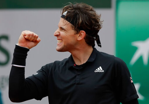 Austria's Dominic Thiem celebrates winning his second round match of the French Open tennis tournament against Jack Sock of the U.S. at the Roland Garros stadium in Paris, France, Wednesday, Sept. 30, 2020. (AP Photo/Alessandra Tarantino)