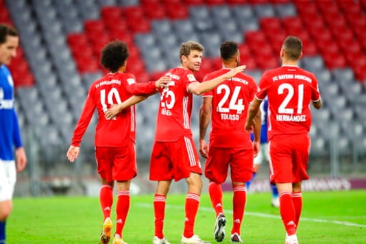 Bayern's Thomas Mueller celebrates with teammates a goal during the German Bundesliga soccer match between FC Bayern Munich and Schalke 04 in Munich, Germany, Friday, Sept. 18, 2020. (AP Photo/Matthias Schrader)