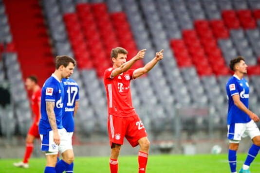 Bayern's Thomas Mueller celebrates after scoring his team's sixth goal, during the German Bundesliga soccer match between FC Bayern Munich and Schalke 04 in Munich, Germany, Friday, Sept. 18, 2020. (AP Photo/Matthias Schrader)