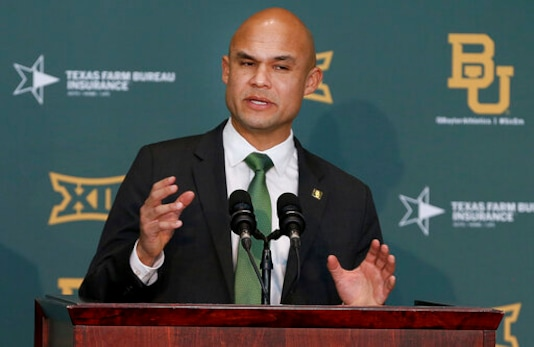 FILE - In this Jan. 20, 2020 file photo, Baylor's new head football coach Dave Aranda addresses the media during an NCAA college football news conference in Waco, Texas.   Aranda will make his delayed debut as Baylor's coach in a quickly arranged and unexpected reunion of old Southwest Conference rivals. Baylor and Houston open this pandemic-altered season Saturday, Sept. 19,  with their first meeting since the SWCs final season in 1995.  (Jerry Larson/Waco Tribune-Herald via AP, File)