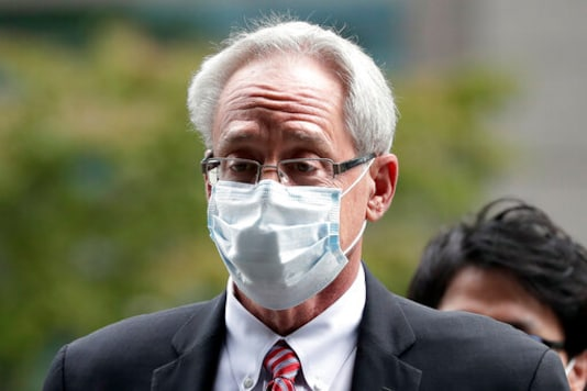 FILE - In this Sept. 15, 2020, file photo, former Nissan Motor Co. executive Greg Kelly arrives for the first trial hearing at the Tokyo District Court in Tokyo. A Nissan employee testified Tuesday, Sept. 29, 2020 that he worked with another former Nissan executive, American Greg Kelly to find ways to pay the automaker's former chairman, Carlos Ghosn without fully disclosing his compensation. (Kiyoshi Ota/Pool Photo via AP, File)