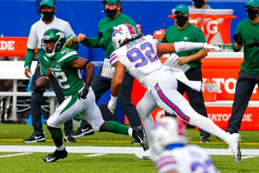 New York Jets wide receiver Jamison Crowder (82) gets past Buffalo Bills defensive end Darryl Johnson (92) after taking a pass from quarterback Sam Darnold and scoring during the second half of an NFL football game in Orchard Park, N.Y., Sunday, Sept. 13, 2020. (AP Photo/Jeffrey T. Barnes)