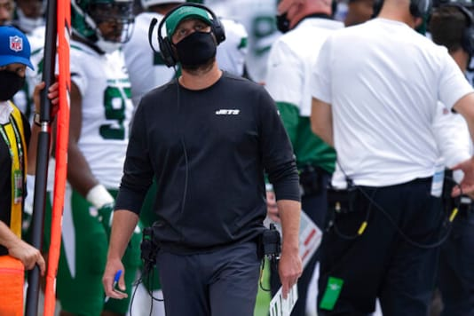 New York Jets head coach Adam Gase walks on the sidelines during an NFL football game between the Indianapolis Colts and New York Jets, Sunday, Sept. 27, 2020, in Indianapolis. Gase is doing all he can to tune out all the negative talk and criticisms aimed directly at him. And there's lots of it. (AP Photo/Zach Bolinger)
