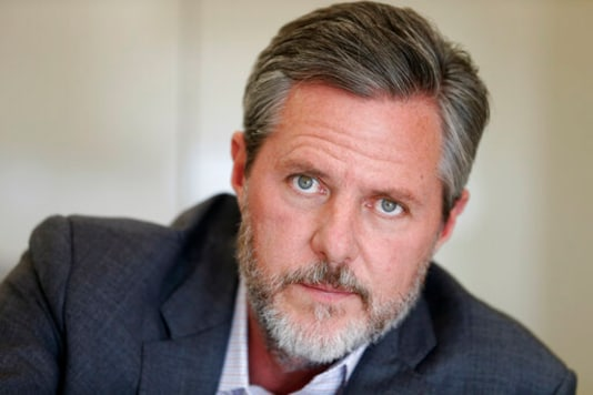 FILE - In this Nov. 16, 2016 file photo, Liberty University President Jerry Falwell Jr., pauses during an interview in his office at the school in Lynchburg, Va. On Tuesday, Aug. 25, 2020, Falwell said that he has submitted his resignation as head of evangelical Liberty University. (AP Photo/Steve Helber, File)