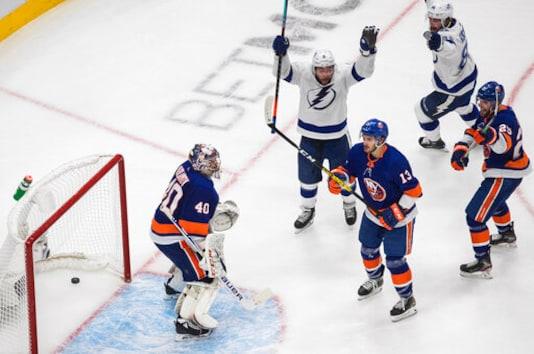 Tampa Bay Lightning center Tyler Johnson (9) celebrates his goal on New York Islanders goalie Semyon Varlamov (40) during the third period of Game 3 of the NHL hockey Eastern Conference final, Friday, Sept. 11, 2020, in Edmonton, Alberta. (Jason Franson/The Canadian Press via AP)