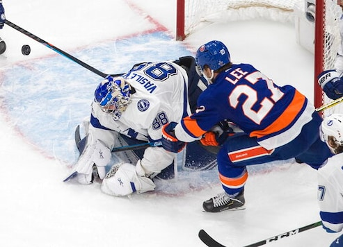 Tampa Bay Lightning goalie Andrei Vasilevskiy (88) makes a save against New York Islanders' Anders Lee (27) during third-period NHL Eastern Conference final playoff game action in Edmonton, Alberta, Sunday, Sept. 13, 2020. (Jason Franson/The Canadian Press via AP)