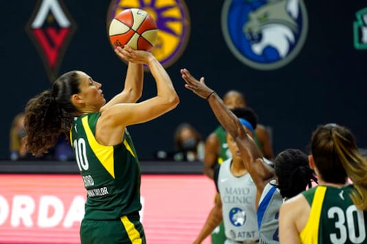 Seattle Storm guard Sue Bird (10) shoots over Minnesota Lynx guard Crystal Dangerfield (2) during the second half of Game 2 of a WNBA basketball semifinal round playoff series Thursday, Sept. 24, 2020, in Bradenton, Fla. (AP Photo/Chris O'Meara)