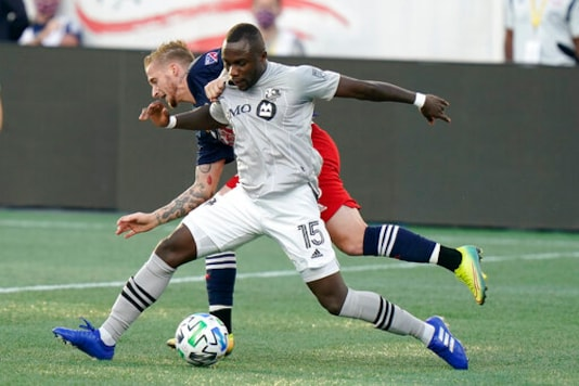 Montreal Impact's Zachary Brault-Guillard, right, and New England Revolution's Alexander Buttner, left, vie for control of the ball during the first half of an MLS soccer match, Wednesday, Sept. 23, 2020, in Foxborough, Mass. (AP Photo/Steven Senne)