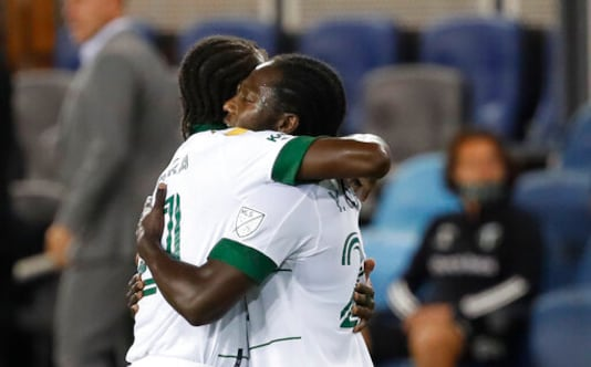 Portland Timbers midfielder Diego Chara, left, celebrates with forward Yimmi Chara, who scored a goal against the San Jose Earthquakes during the first half of an MLS soccer match Wednesday, Sept. 16, 2020, in San Jose, Calif. (AP Photo/Josie Lepe)