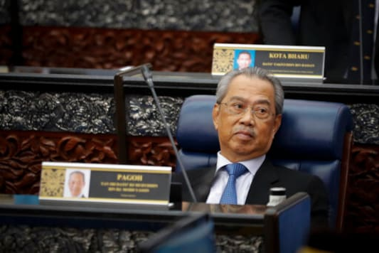Prime Minister Muhyiddin Yassin attending parliament session at parliament lower house in Kuala Lumpur, Malaysia, Monday, July 13, 2020. (AP Photo/Vincent Thian)