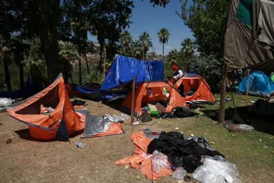 Tents and belongings lay scattered on the ground a day after farmers ousted National Guard troops from La Boquilla Dam in order to close the dam's valves and reduce the flow of water toward the United States, in Chihuahua State, Wednesday, Sept. 9, 2020. Tuesday's clash between hundreds of farmers and National Guard troops was the latest flashpoint in a months-long conflict over the Mexican government's attempts to pay off its water debt with the United States over objections of local farmers. (AP Photo/Christian Chavez)
