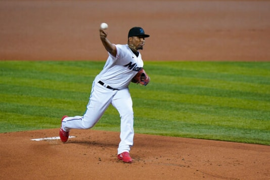 Miami Marlins' Sixto Sanchez pitches during the first inning of the first game of a baseball doubleheader against the Washington Nationals, Friday, Sept. 18, 2020, in Miami. (AP Photo/Wilfredo Lee)