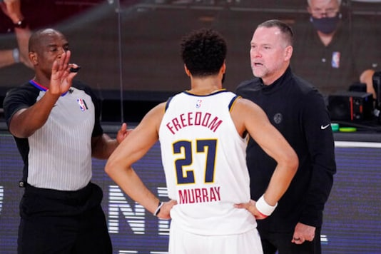Denver Nuggets head coach Michael Malone talks with Denver Nuggets' Jamal Murray (27) during the second half of an NBA conference final playoff basketball game against the Los Angeles Lakers Saturday, Sept. 26, 2020, in Lake Buena Vista, Fla. (AP Photo/Mark J. Terrill)