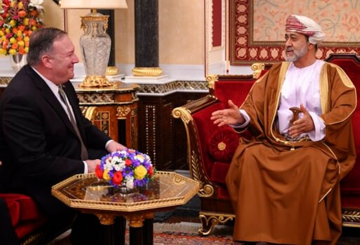 FILE - In this Feb. 21, 2020 file photo, Oman's Sultan Haitham bin Tariq meets with US Secretary of State Mike Pompeo, left, at al-Alam palace in the capital Muscat, Oman. The new sultan, while quietly making his mark, faces real challenges ahead. Oman has billions in looming loan repayments, including from China, and needs even more money as its youthful population wants jobs and its government cannot afford the cradle-to-grave benefits given in other Gulf Arab nations. (Andrew Caballero-Reynolds/Pool via AP, File)
