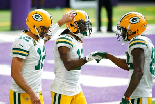 Green Bay Packers wide receiver Davante Adams, center, celebrates with teammates Aaron Rodgers, left, and Marquez Valdes-Scantling, right, after catching a 1-yard touchdown pass during the second half of an NFL football game against the Minnesota Vikings, Sunday, Sept. 13, 2020, in Minneapolis. (AP Photo/Bruce Kluckhohn)